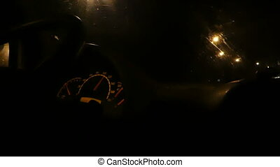 The view from a moving car with sparkling street lamps at night.