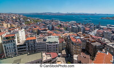The view from Galata Tower to Golden Horn and Bosphorus, city skyline with red roofs timelapse, Istanbul, Turkey