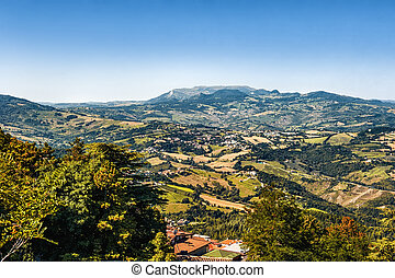 The view from the fortress of San Marino on the mountain and surroundings in a Sunny summer day.