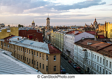 The view from the height on the building of the Spasskaya Fire station No. 2 and the roof at sunset in St. Petersburg.