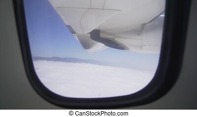 The view from the window - an airplane wing and a turbo ...
