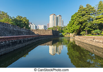 The view of Fort Santiago and buildings along the Pasay River, Intramuros, Manila, The Philippines.