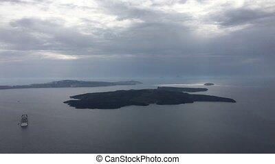 the view of Nea Kameni from Oia near Santorini, cyclades, Greece
