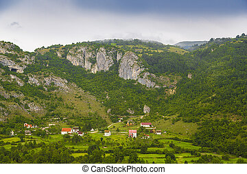 The view of the mountains and the village.