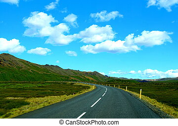 The view of the scenic drive on an empty highway on the Ring Road, Iceland during the summer