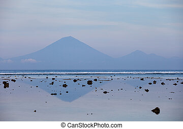 The view of the volcano Agung from Gili Trawangan in the early morning at low tide
