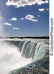 Niagara Falls - The view of the waterfall on the blue sky...