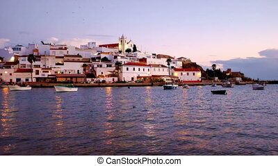The village Ferragudo in Portugal at twilight