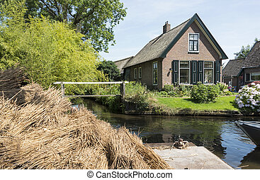 the village Giethoorn in Holland - Hay and bales of straw...