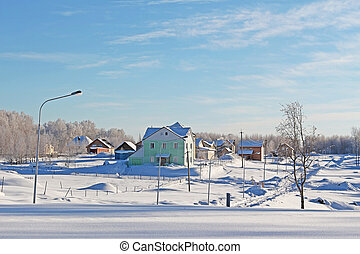 The village in a sunny day in cold winter