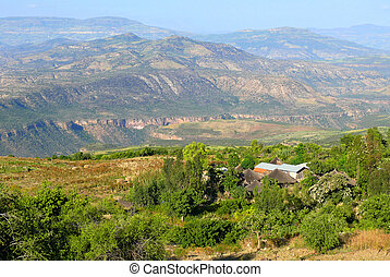 The village is in the mountains, close to Canyon. Landscape of mountains around. Africa, Ethiopia.