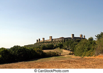 the village of Monteriggioni Castle perched atop a hill in Tuscany