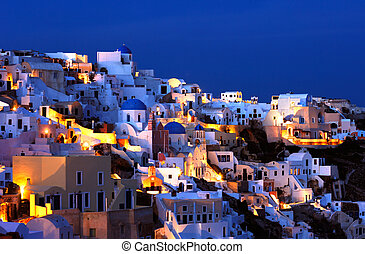 The village of Oia at dusk - Image shows the village of Oia ...