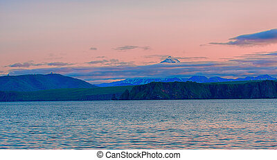 The Viluchinsky volcano and Avacha Bay at sunset on the Kamchatka Peninsula