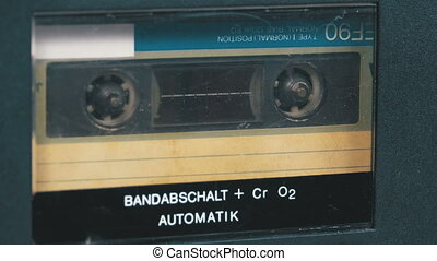 The Vintage Audio Cassette in the Tape Recorder Rotates....