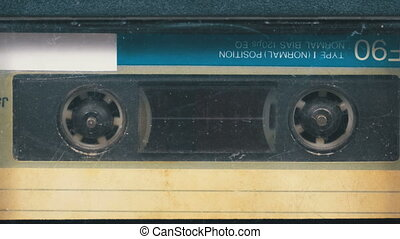 The Vintage Audio Cassette in the Tape Recorder Rotates