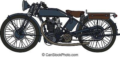 The vintage dark motorcycle