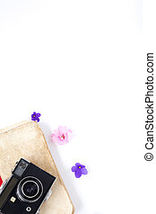the vintage film camera old book flower and tea on white background