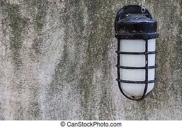 The vintage lamp on gray cement wall