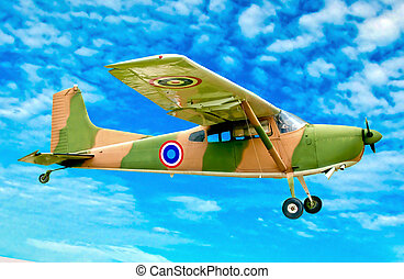 The Vintage plane of worlld war on blue sky background
