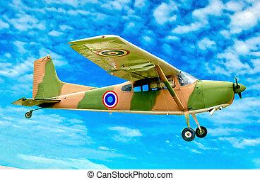 The Vintage plane of worlld war on blue sky background
