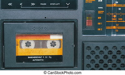 The Vintage Yellow Audio Cassette in the Old Tape Recorder Rotates.