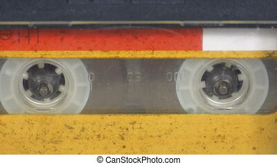 The Vintage Yellow Audio Cassette in the Tape Recorder...