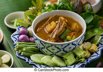 The viscera of mackerel fish paunch hot spicy curry or fish organs sour soup with vegetables, Thai food