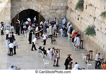 JERUSALEM - APRIL 19:Visitors at the Wailing Wall on April 19 2010 in Jerusalem, Israel. It's arguably the most sacred site recognized by the Jewish faith outside of the Temple Mount itself.