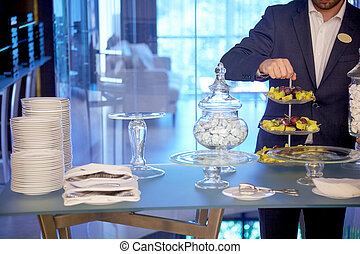 The waiter serving table