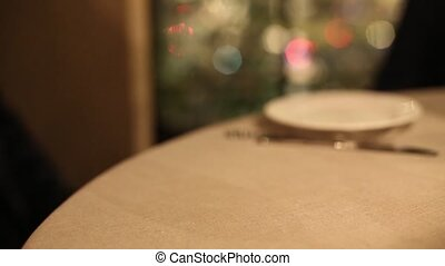 The waiter takes the salad in a restaurant close up