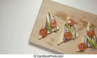 The waitress serves tapas on the board, the waiter pours the...