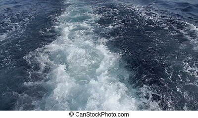 The wake of a boat cutting through the sea. - The wake of a...
