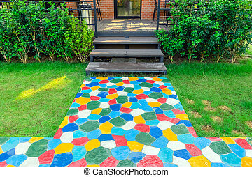 The walkway in the garden are paved with brightly colored ...