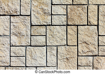 The wall lined with stone tiles