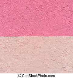 The wall of an old house of two shades of pink. Texture of the peeled surface.