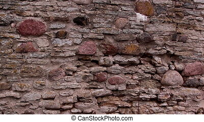 The wall of the castle made of stones - The large wall of...