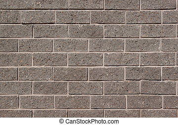 The wall of the house is lined with gray bricks. Used as a background.