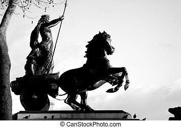 Black and White statue of warrior and horse drawn chariot