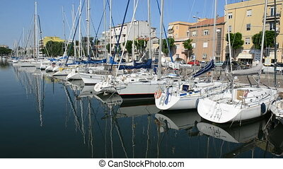 The water channel with parked sail yachts, Rimini, Italy