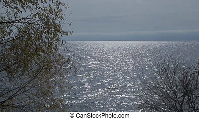 The water surface of the lake Baikal is waving and shining...