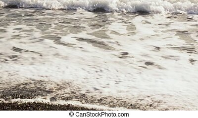 The wave rolls to the shore - The sea wave rolls ashore with...