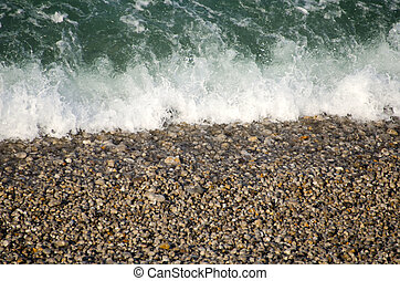 the waves and pebbles