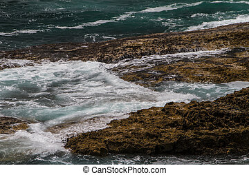 The waves fighting about deserted rocky coast of Atlantic ocean, Portugal