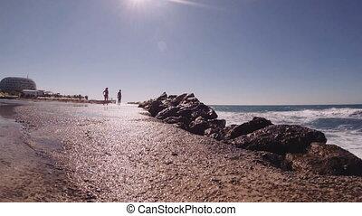 The waves of the Mediterranean Sea crashing it rocks