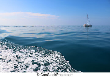 The waves of the sea and sailing boats.