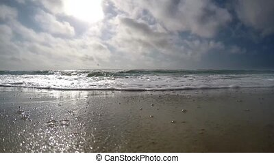 The waves of the sea with a very fast-moving clouds