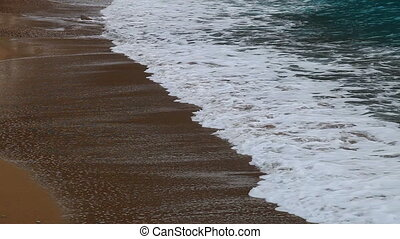 The waves rolled on a beach