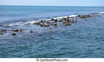 The waves rolled on the rocks. Tyrrhenian Sea