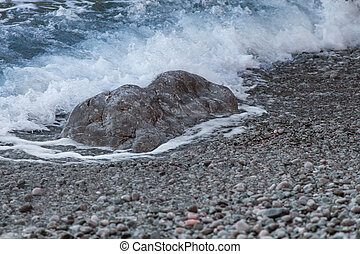 The waves run over ashore - Sea wave is incident on rocky ...